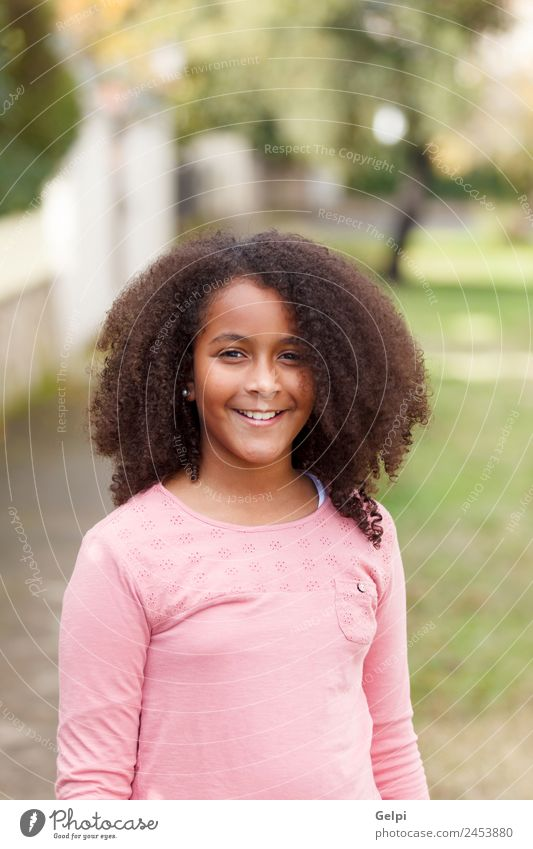 Cute African American girl smiling in the street with afro hair Joy Happy Beautiful Winter Child Human being Toddler Infancy Nature Park Afro Smiling Happiness