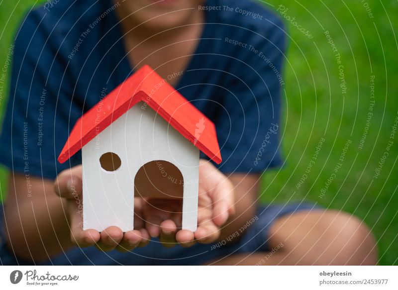 Little boy holding house Woman Human being White Hand House (Residential Structure) Adults Building Business Small Flat (apartment) Metal Open Authentic Success