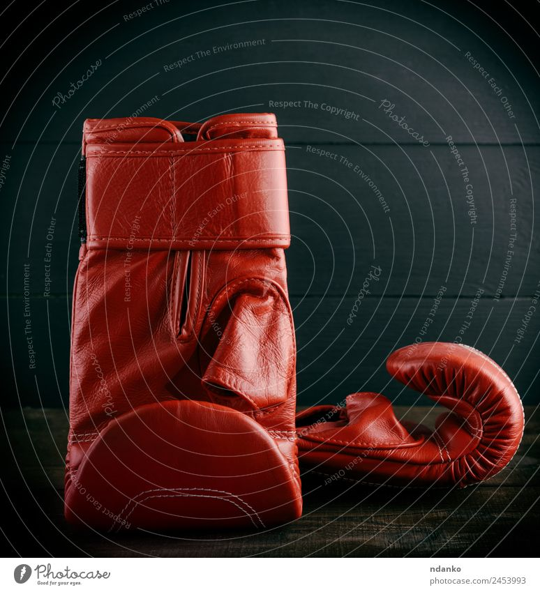 pair of red leather gloves for boxing Sports Success Leather Gloves Old Red Black Boxing background equipment Sportswear Boxing glove Consistency