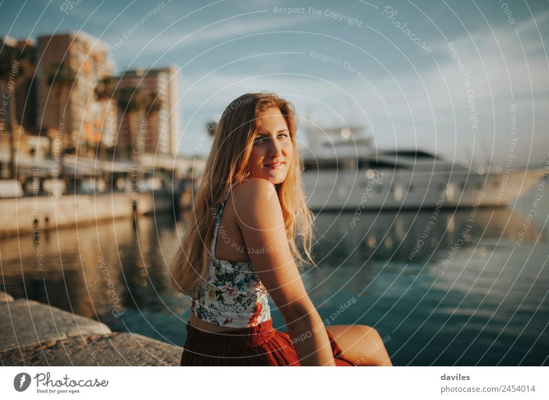 Blonde woman sitting at the harbour Woman Human being Vacation & Travel Youth (Young adults) Young woman Summer Blue Water White Ocean 18 - 30 years Adults