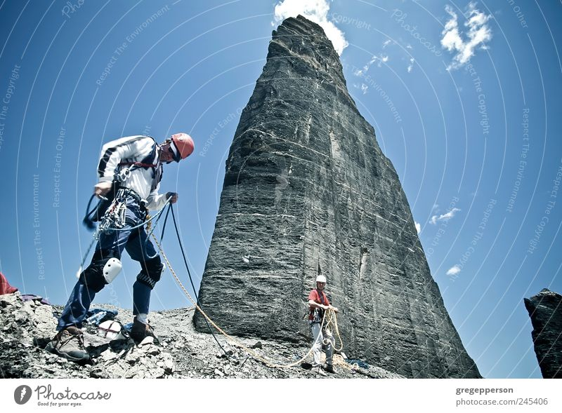 Team of climbers reaching the summit. Human being Man Adults Life Environment Sports Mountain Friendship Hiking Masculine Adventure Rope Success Climbing