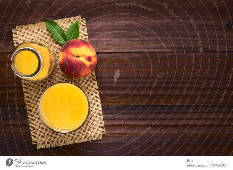 Peach Juice or Nectar Fruit Beverage Fresh food drink drupe Refreshment sweet glass healthy overhead copy space Horizontal refreshing ripe ingredient