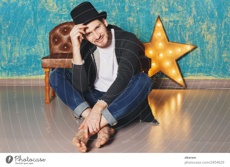 the guy in the hat sitting near the lamp-star Lifestyle Leisure and hobbies Sports Work and employment Profession Masculine Young man Youth (Young adults) 1