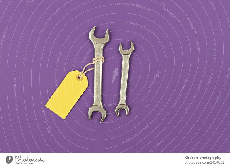 Two wrench large and small with price tag purple background Man Adults Lifestyle Yellow Love Family & Relations Happy Feasts & Celebrations Copy Space Above