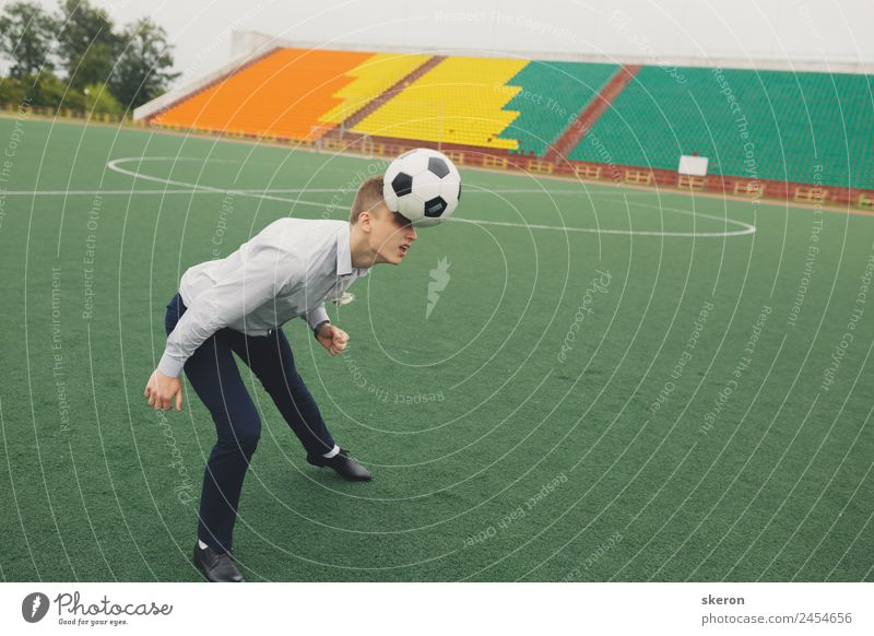 office worker plays football at the stadium Human being Youth (Young adults) Young man 18 - 30 years Adults Legs Sports Fashion Hair and hairstyles Head