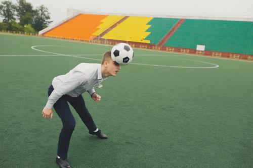 office worker plays football at the stadium Sports Fitness Sports Training Sportsperson Sports team Goalkeeper Soccer Foot ball Sporting Complex Football pitch