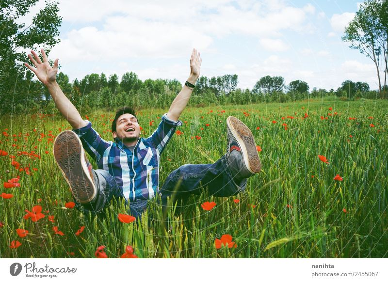 Young happy man having fun in a field of green wheat Lifestyle Joy Healthy Wellness Contentment Human being Masculine Young man Youth (Young adults) Man Adults
