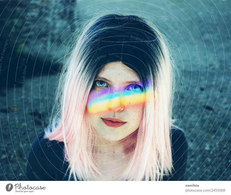 Artistic portrait of a young woman with a rainbow in her face Lifestyle Style Design Beautiful Hair and hairstyles Skin Face Human being Feminine Young woman