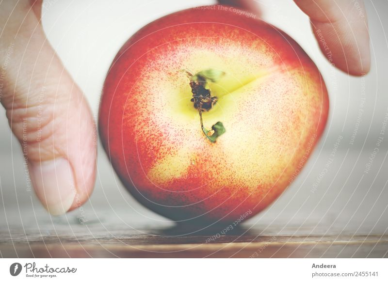 Fingers lay a nectarine on a table top Food fruit Nectarine Nutrition Vegetarian diet Fasting Slow food Finger food Vegan diet Healthy Healthy Eating Table Skin