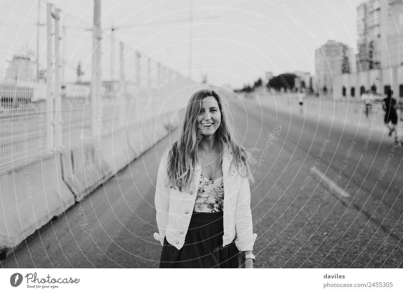 Close up portrait of blonde girl standing in the middle of the road. Black and white. Lifestyle Vacation & Travel Trip City trip Human being Feminine