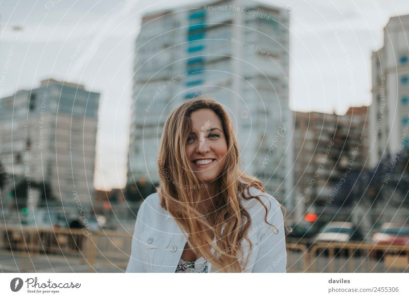Happy casual white woman smiling and posing in the street. Lifestyle Joy Leisure and hobbies Vacation & Travel Trip City trip Human being Feminine Young woman