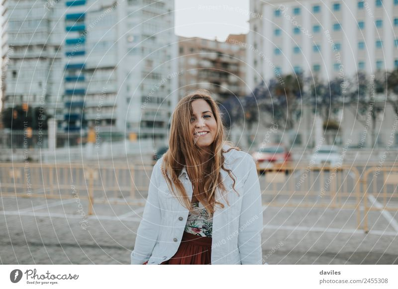Young smiling woman standing in the street and looking at camera. Lifestyle Trip City trip Summer Human being Young woman Youth (Young adults) Woman Adults 1