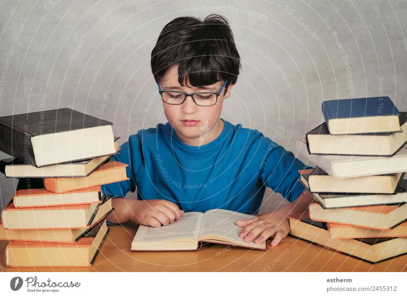 boy reading books Lifestyle Relaxation Leisure and hobbies Reading Adventure Child School Study Human being Masculine Toddler Infancy 1 8 - 13 years Culture