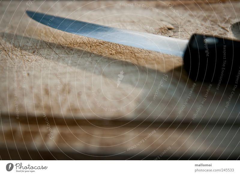 Knife lies on wooden board Knives Chopping board Wooden board Manual cooking appliances tart Brown Black Silver Blade Dull cut Furrow Point Metal Dangerous Risk