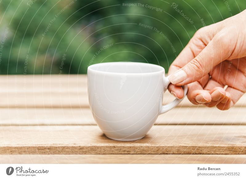 Woman Hand Raising A Cup Of Coffee From Wooden Table In Garden Background picture Green Breakfast Morning Café Light White Drinking Espresso Food Hot Beverage