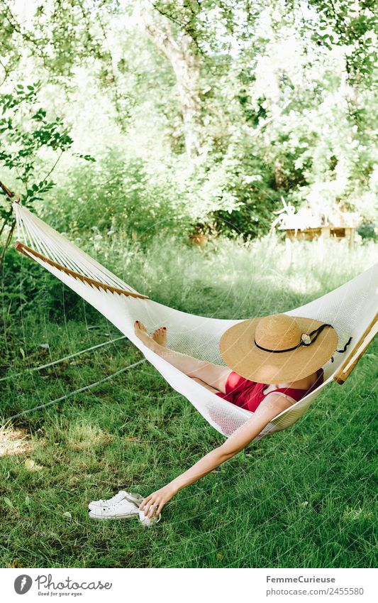 Woman Human being Youth (Young adults) Young woman Tree Relaxation 18 - 30 years Adults Lifestyle Meadow Feminine Garden Lawn Dress Hammock To have a coffee