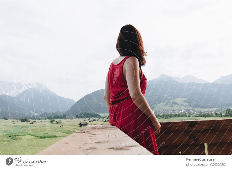 Young woman enjoying the view of the alps from a balcony Feminine Youth (Young adults) Woman Adults 1 Human being 18 - 30 years 30 - 45 years Nature Relaxation