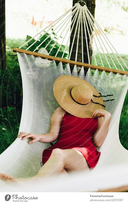 Young woman relaxing in a hammok Feminine Youth (Young adults) Woman Adults 1 Human being 18 - 30 years 30 - 45 years Relaxation Hammock Sunhat Shadow Summer