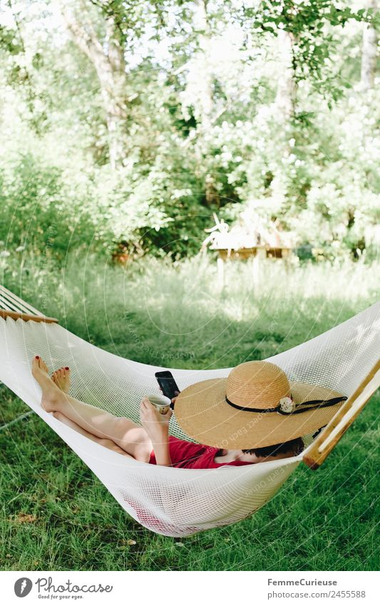 Young woman relaxing in a hammok Youth (Young adults) Woman Adults 1 Human being 18 - 30 years 30 - 45 years Nature Relaxation Garden Hammock Break Shadow