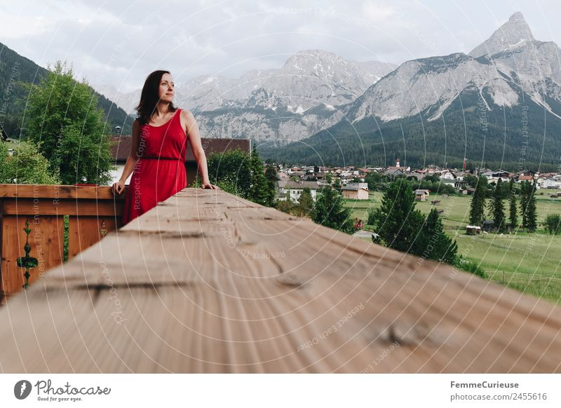 Young woman enjoying the view of the alps from a balcony Feminine Youth (Young adults) Woman Adults 1 Human being 18 - 30 years 30 - 45 years Relaxation Dress