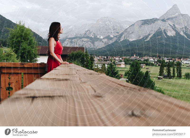 Young woman on the balcony who enjoys the view of the mountains Feminine Youth (Young adults) Woman Adults 1 Human being 18 - 30 years 30 - 45 years Nature
