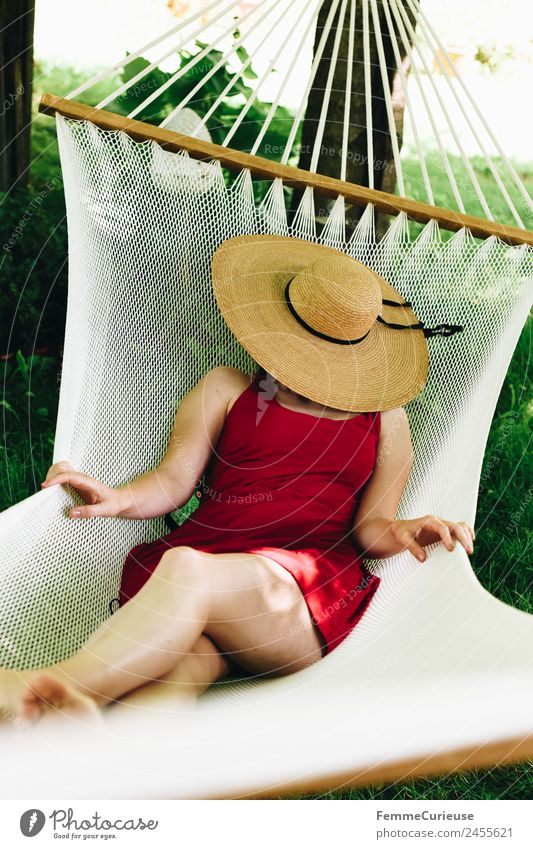 Young woman relaxing in a hammok Feminine Youth (Young adults) Woman Adults 1 Human being 18 - 30 years 30 - 45 years Relaxation Sunhat Hammock Garden Dress