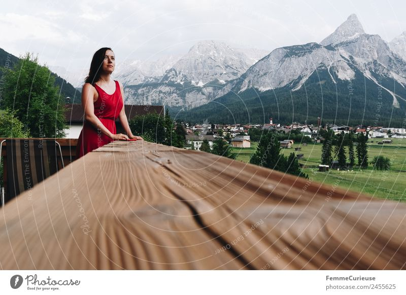 Young woman enjoying the view of the alps from a balcony Feminine Youth (Young adults) Woman Adults 1 Human being 18 - 30 years 30 - 45 years Relaxation Balcony