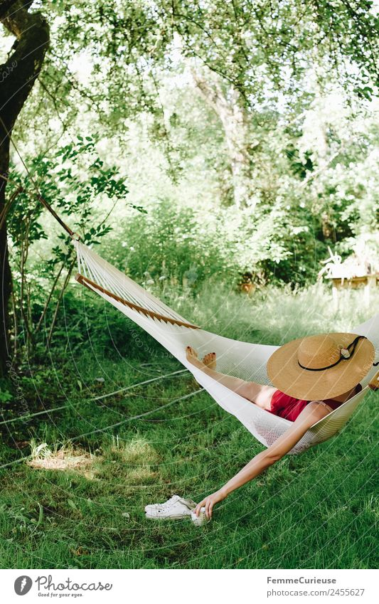 Young woman relaxing in a hammok Feminine Youth (Young adults) Woman Adults 1 Human being 18 - 30 years 30 - 45 years Relaxation Sunhat Hammock Summer
