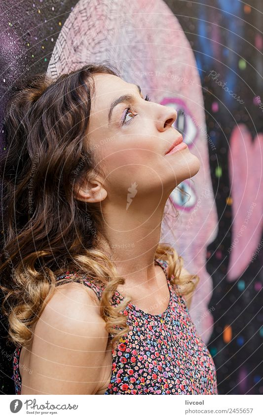 Thoughtful woman leaning on a wall with graffiti Lifestyle Happy Beautiful Face Relaxation Calm Human being Feminine Woman Adults Female senior Head 1