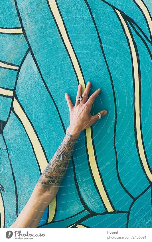 Tattooed arm on wall with graffiti Lifestyle Happy Beautiful Relaxation Calm Human being Feminine Woman Adults Arm Hand Fingers 1 45 - 60 years Art Painter