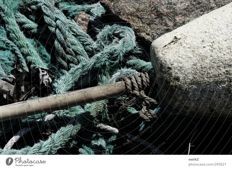 Svanhalla Closing time Harbour Stone Old Near Natural Gloomy Gray Black White Calm Peaceful Things Rope Knot Material Anchoring ground Colour photo