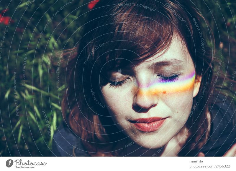 Young woman with a rainbow in her face Lifestyle Style Design Beautiful Wellness Harmonious Well-being Senses Relaxation Meditation Human being Feminine