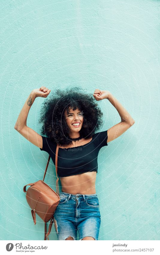 Smiling black woman with curly hair raising arms outdoors Woman Human being Youth (Young adults) Young woman Beautiful Joy 18 - 30 years Black Street Adults