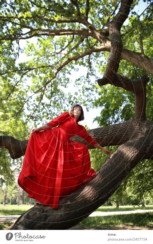 ulreka Feminine Woman Adults 1 Human being Beautiful weather Tree Park Dresden Dress Brunette Long-haired Observe Movement To hold on Looking Stand Free