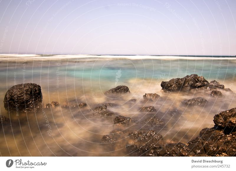 Fascination Exposure Ocean Island Waves Landscape Water Cloudless sky Beautiful weather Rock Coast Bay Reef Blue Brown Crete Turquoise Stone Calm Horizon