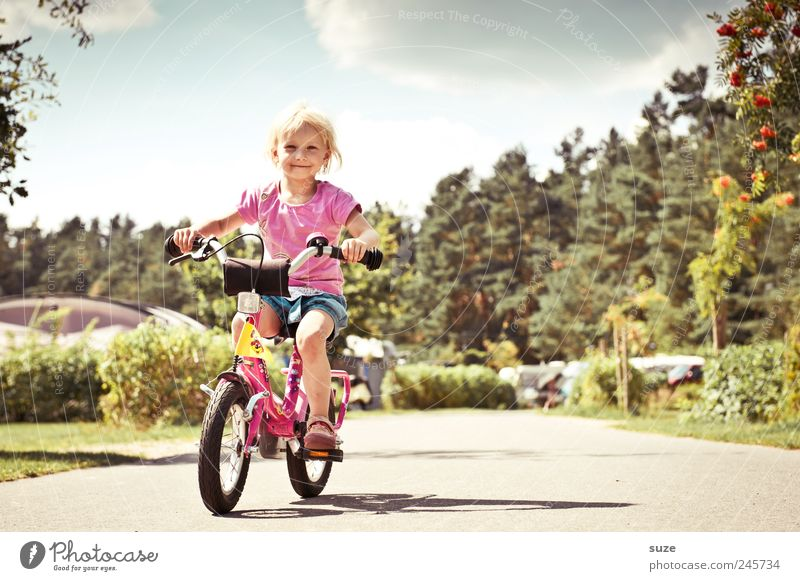 Human being Child Girl Summer Lanes & trails Small Infancy Blonde Bicycle Study Childhood memory Safety Cute Driving Target Beautiful weather