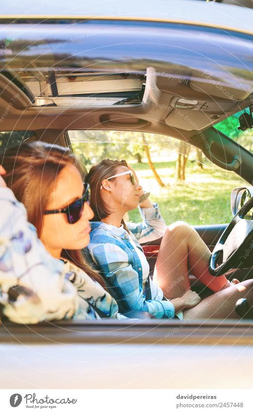 Two young women resting sitting inside of car Lifestyle Joy Happy Beautiful Relaxation Leisure and hobbies Vacation & Travel Trip Summer Sun Human being Woman