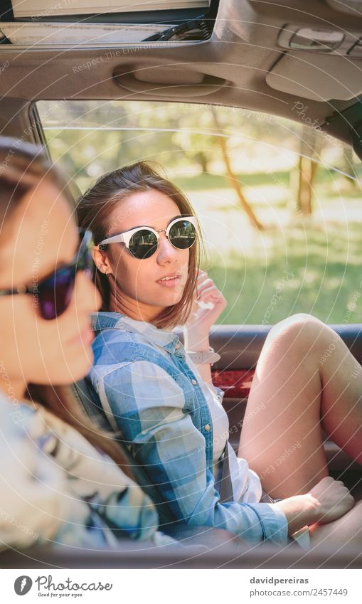 Two young women resting sitting inside of car Woman Human being Nature Vacation & Travel Youth (Young adults) Summer Beautiful Landscape Sun Tree Relaxation Joy