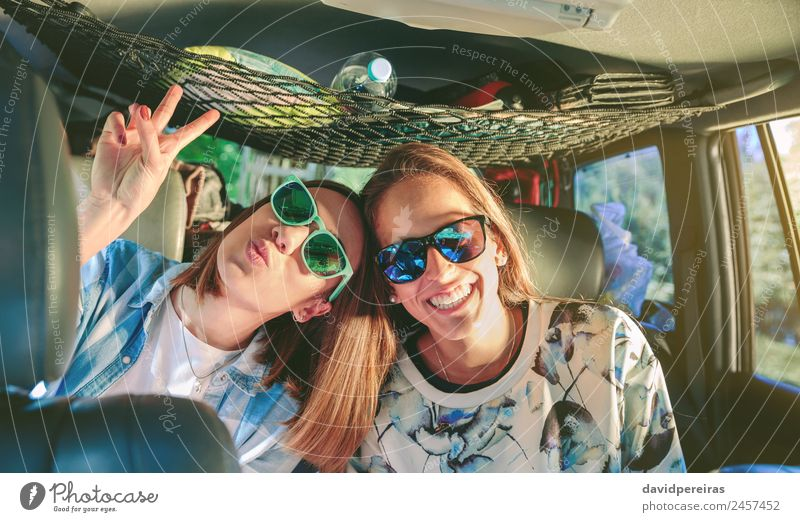 Happy women laughing and having fun inside of car Lifestyle Joy Beautiful Leisure and hobbies Vacation & Travel Trip Adventure Success Human being Woman Adults