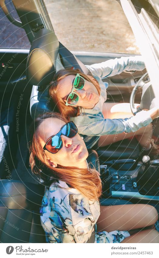Happy women having fun inside of cabriolet car Woman Human being Vacation & Travel Youth (Young adults) Beautiful Joy Face Street Adults Lifestyle Love Couple