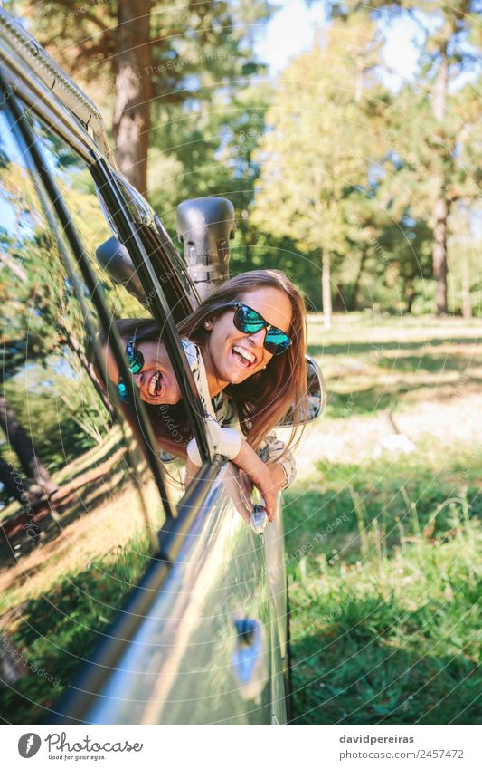 Happy young woman looking back through the window car Lifestyle Joy Beautiful Relaxation Leisure and hobbies Vacation & Travel Trip Summer Sun Human being Woman