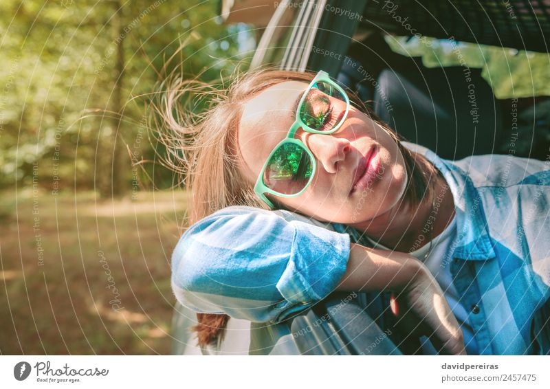 Young woman with her head over the door car Woman Human being Nature Vacation & Travel Youth (Young adults) Summer Beautiful Landscape Relaxation Face Adults