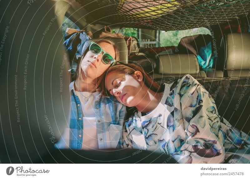 Tired women friends sleeping in a rear seat car Lifestyle Beautiful Relaxation Leisure and hobbies Vacation & Travel Trip Adventure Human being Woman Adults