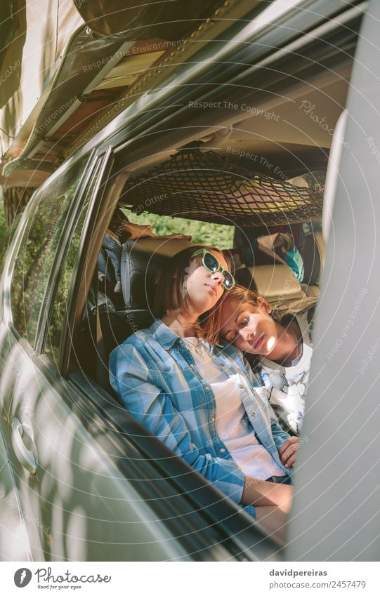 Tired women friends sleeping inside of car Lifestyle Beautiful Relaxation Leisure and hobbies Vacation & Travel Trip Adventure Human being Woman Adults