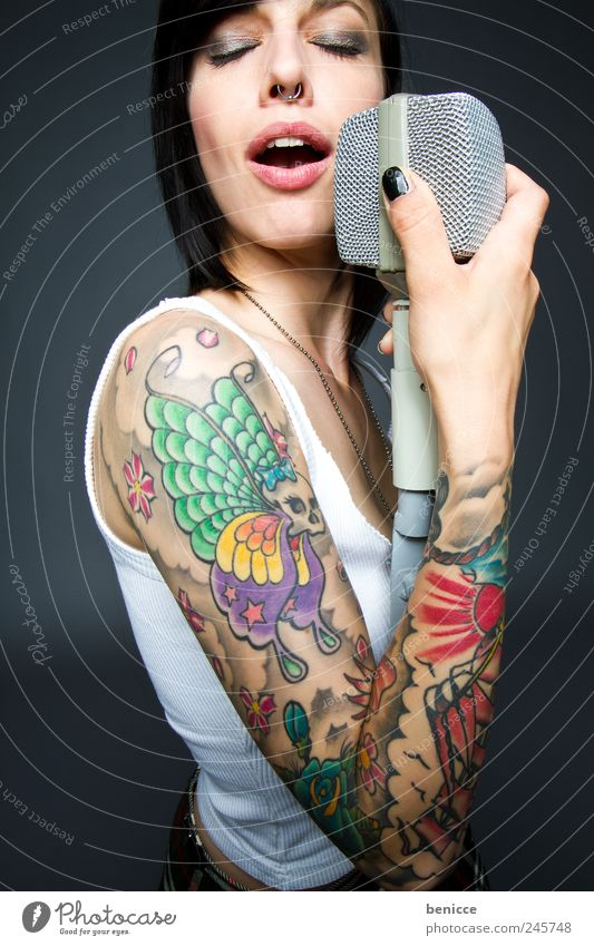 colored voices Human being Feminine Woman Adults Punk Concert Singer Tattoo Emotions Colour Tattooed Dye Gaudy Microphone Song youthful Rock music Rocker