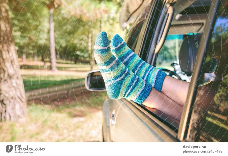 Female legs with socks resting over open window car Lifestyle Beautiful Relaxation Leisure and hobbies Vacation & Travel Trip Freedom Summer Human being Woman