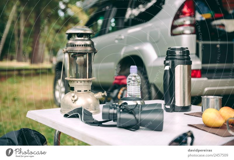 Oil lamp, thermos and binoculars over camping table Nature Vacation & Travel Summer Green Landscape Tree Relaxation Loneliness Joy Forest Mountain Lifestyle
