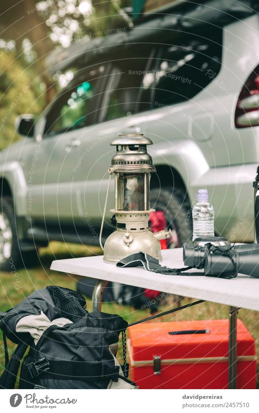 Oil lamp and binoculars over camping table Nature Vacation & Travel Summer Green Landscape Tree Relaxation Loneliness Joy Forest Mountain Lifestyle Autumn Grass