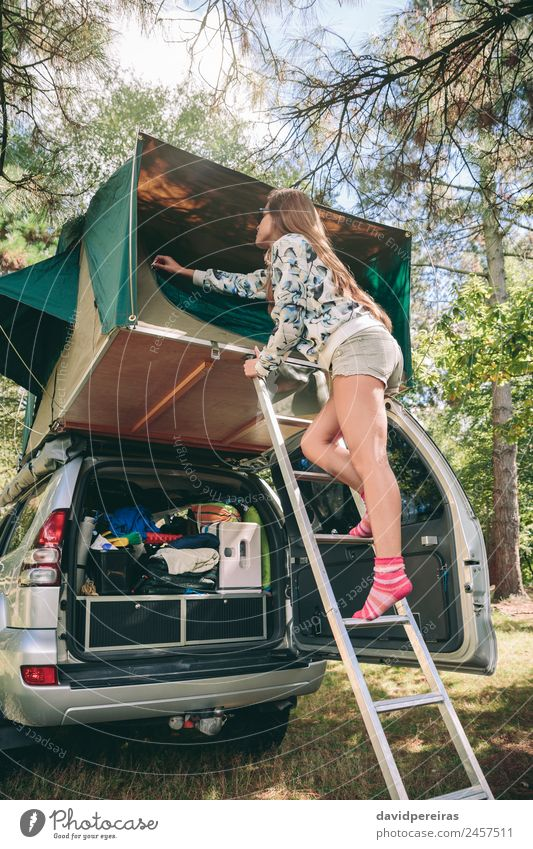 Woman standing in ladder opening tent over car Human being Sky Nature Vacation & Travel Summer Tree Relaxation Joy Forest Mountain Adults Lifestyle Autumn Happy