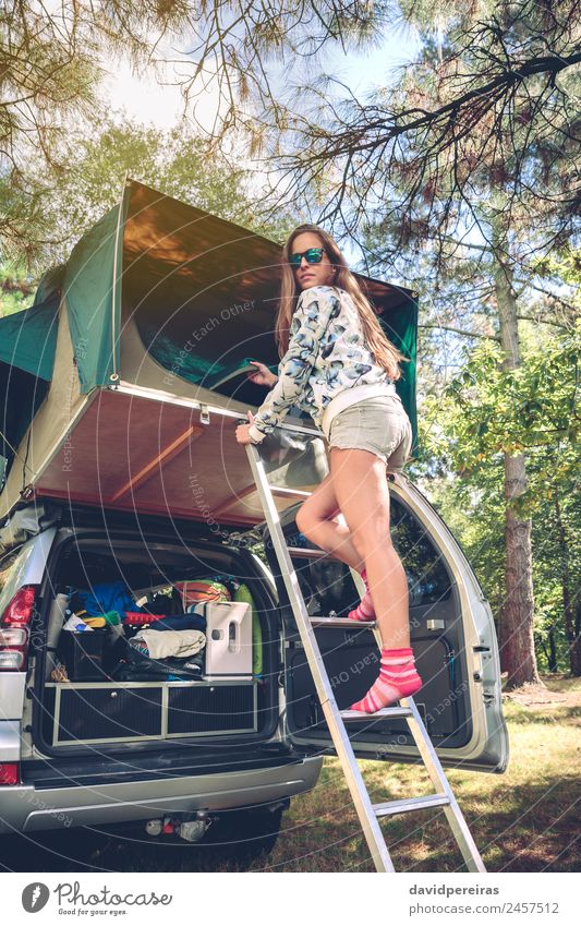 Woman standing in ladder opening tent over car Human being Nature Vacation & Travel Summer Tree Relaxation Joy Forest Mountain Adults Lifestyle Autumn Happy